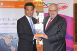 Dr. Edwin J. Feulner (right), president of the Heritage Foundation, presents the 2013 Index of Economic Freedom to the Hon. C Y Leung, Chief Executive, Hong Kong Special Administrative Region, Jan. 10 in Hong Kong.