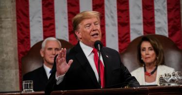 3a02e637a President Donald Trump, with Speaker Nancy Pelosi and Vice President Mike  Pence looking on, delivers the State of the Union address.